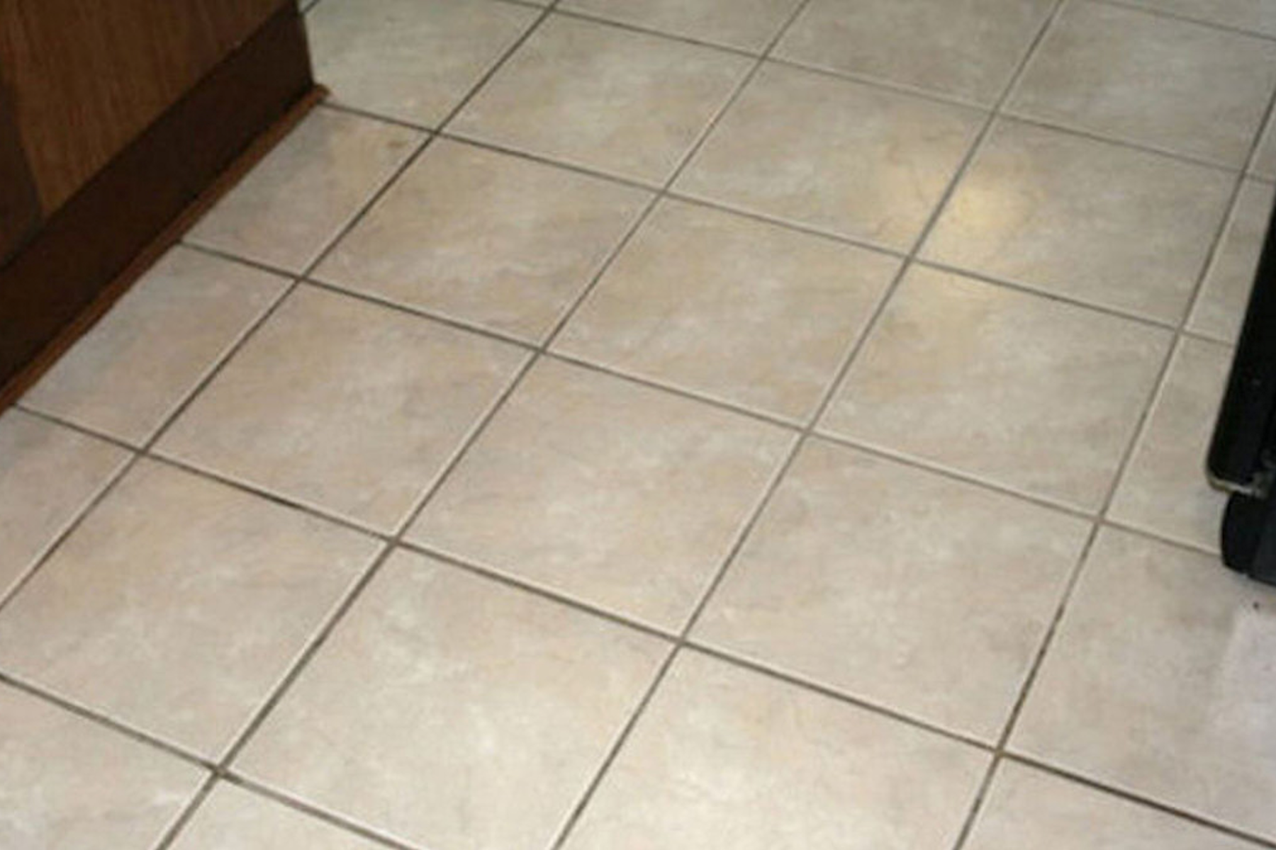 Kitchen tiles with bad stains before colour seal is applied