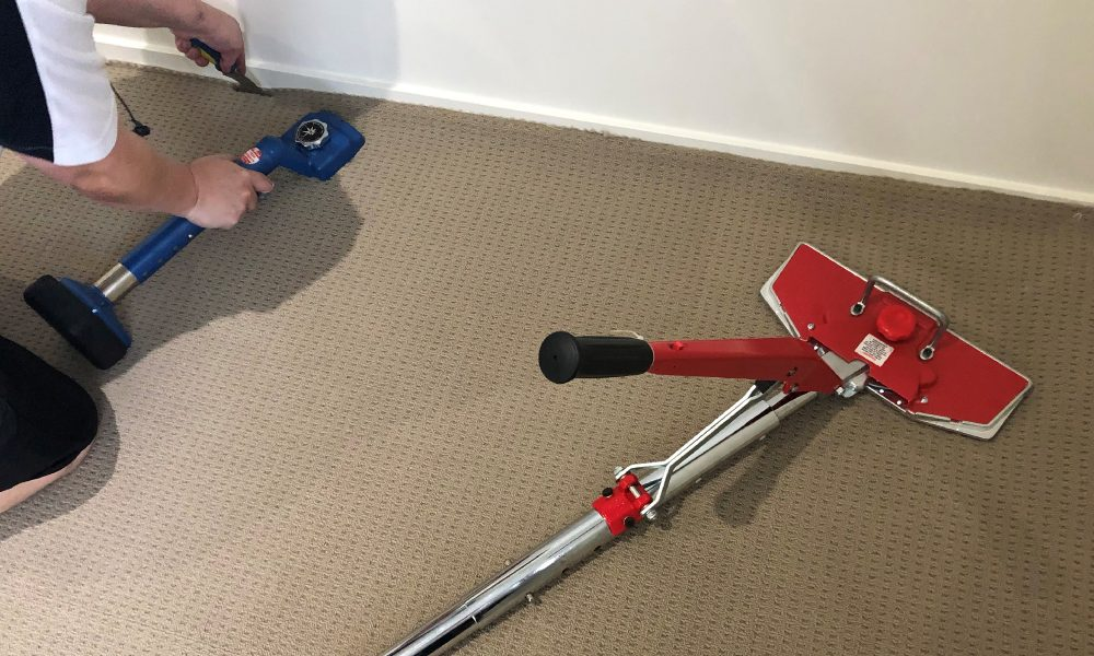 Carpet Repair - Grime Fighters Cleaning re-laying a carpet